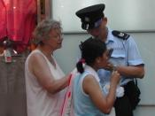A woman asking a Hong Kong policeman for directions.