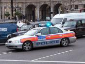 MPS officers responding to an emergency call in a police car in 2005