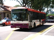 A SBS Transit Scania L94UB nearing Bras Basah MRT Station, Singapore.