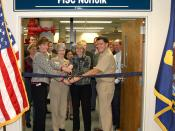 English: NORFOLK (Dec. 16, 2009) Cutting the ribbon at the opening of the Fleet and Industrial Supply Center Norfolk Strategic Sourcing Office, from left to right: Donna Reuss, deputy director of contracting, Capt. Ruth Christopherson, commanding officer,