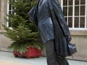 Bronze Statue of Phillip Larkin, by sculptor Martin Jennings, at Hull Paragon Interchange