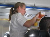 English: Stewardess in a Swiss flight filling orangejuice into a cup