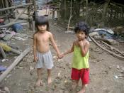 Picture of siblings living in extreme poverty in El Salvador.