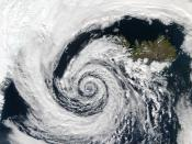 A large extratropical low-pressure system swirls off the southwestern coast of Iceland.