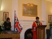 A British citizenship ceremony in 2005, at the London Borough of Tower Hamlets. The Mayor of Tower Hamlets is shown.