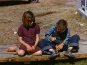 [Boy] building a model airplane girl watches, FSA ... camp, Robstown, Tex. The girl is featured on the cover of the Penguin Modern Classics edition of Carson McCullers' The Member of the Wedding (ISBN 0141182822).