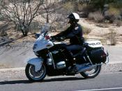 A motor officer patrolling in Arizona on a BMW