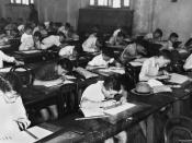 English: School children doing exams inside a classroom, 1940. Children sitting at their school desks in a classroom doing scholarship examinations, 16 April 1940.
