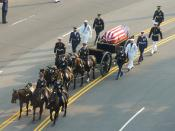Ronald Reagan's casket, on a horse-drawn caisson, being pulled down Constitution Avenue to the Capitol