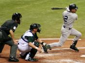 Jeter connects for a hit against the Tampa Bay Devil Rays.