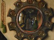 Detail from Jan van Eyck's 1434 Arnolfini Marriage showing the convex mirror place on the wall behind the couple.