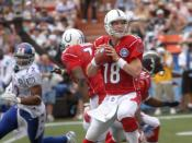 AFC quarterback Peyton Manning, of the Indianapolis Colts, looks down field for a open man. Manning threw three interceptions during the first half of the 2006 Pro Bowl in Hawaii.