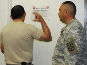 Master Sgt. Urbano Sosa demonstrates the job of an observer for a UPL collection exercise. As observer, maintaining a direct line of sight with a specimen bottle at all time helps to ensure a proper chain of custody and prevents tampering or altering of a