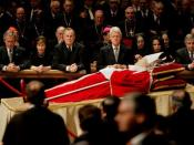 Pictured from left, The then US President George W. Bush, First Lady Laura Bush, former President George H. W. Bush, former President Bill Clinton, Secretary of State Condoleezza Rice and White House Chief of Staff Andrew Card pay their respects to Pope J