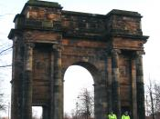 Police officers on horseback in front of McLennan Arch at sunset. Glasgow Green, Glasgow, Scotland.