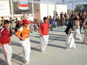 English: A group of children rush to the finish line in a rice sack race during the Fallujah Sports Day in Fallujah, Iraq.
