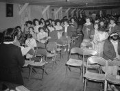 English: Sunday school class, Manzanar Relocation Center, California People in church service, standing, holding hymnals. MEDIUM: 1 negative : safety film.