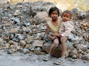 English: Kids on a road near Rishikesh, India. They are probably siblings and hanging around while their parents are busy building the road.