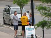English: People engaging in casual conversation on a sidewalk in Owen Sound, Ontario, Canada.