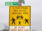 Pedestrian crossing sign on Queens Boulevard in Elmhurst