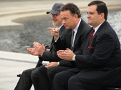 Actor Tom Hanks, center, points to 250 veterans at the World War II Memorial March 11, during a speech by HBO co-president Richard Plepler (not pictured). Fellow executive produce Steven Spielberg is seated on Hanks' right.