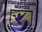 English: Patch showing the logo of the U.S. Fish and Wildlife Service on an USFWS employee's uniform.