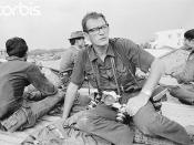 Saigon 10 May 1968 - British combat photographer Larry Burrows sits with Vietnamese soldiers during the second offensive on Saigon in the Vietnam War.
