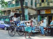 English: A man-pulled rickshaw in Kolkata Deutsch: Eine von menschenhand gezogene Rikscha in Kolkata