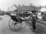 Nederlands: Repronegatief. Rikshaw, voortgetrokken door een chinese man, Medan Caption: A Chinese rickshaw puller posing with his rickshaw in Medan :(Note: he is not actually pulling the rickshaw in the photo, so I have put