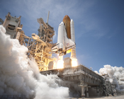 English: An exhaust plume surrounds the mobile launcher platform on Launch Pad 39A , Kennedy Space Center, Fla., as space shuttle Atlantis lifts off on the STS-132 mission on May 14. STS-132 is the 132nd shuttle flight, the 32nd for Atlantis and the 34th