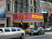 McDonalds on West 42nd Street in Times Square, New York City. Madame Tussauds wax museum is seen to the right. Number plates on cars have been blurred. Category:Images of New York City