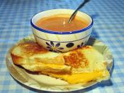 English: I took this picture. Grilled cheese sandwich with white bread, American cheese, and tomato soup.