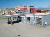 2005.07.05 - Bensinstasjonen foran DORA 1. Fyringsbunkeren og DORA 2 i bakgrunnen.