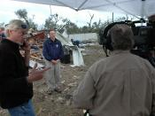 English: Lady Lake, Fla., February 3, 2007 -- FEMA Director David Paulison prepares for a live interview with ABC News. The director described how FEMA is responding to tornadoes that struck central Florida last night. Mark Wolfe/FEMA