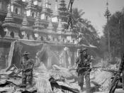 THE BRITISH ARMY IN BURMA DURING THE SECOND WORLD WAR, Two British soldiers on patrol in the ruins of the Burmese town of Bahe during the advance on Mandalay.