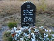 Memorial for Margot and Anne Frank at the former Bergen-Belsen site, along with floral and pictorial tributes.