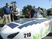 Ikumi Yasuka, a student at Tamagawa University, drives a Solar-Hydrogen vehicle.