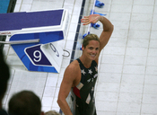 American swimmer Dara Torres waves to the crowd after taking silver in the women's 50m freestyle event.