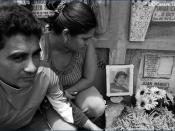 English: Family members of slain gang member at his gravesite (Guatemala, 2005).