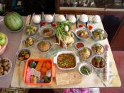 Food is offered to the ancestors during the annual Ghost Festival