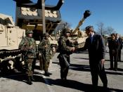 English: President George W. Bush greets army soldiers in front of tank equipment during a visit to Fort Hood in Killeen, Texas, Friday, Jan. 3, 2003.