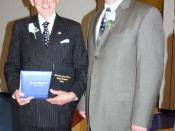 English: David H. Murdock (left) receiving the high school diploma he didn't get. He has in his hands the diplomas from he should have graduated and the 2009 diploma. Next to him is the the high school principal.