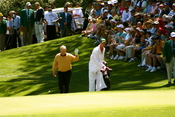 Jack Nicklaus, with his son Jack Nicklaus II as his caddy, walking up to the 9th green during the 2006 par-3 contest held prior to the Masters Tournament.