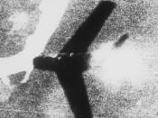 English: Fifth Air Force, Korea--Smoke pours from a swept-wing Russian built MIG-15 as bullets spatter from the blazing machine guns of a U.S. Air Force F-86