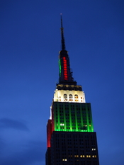 English: Empire State Building lit up red and green.