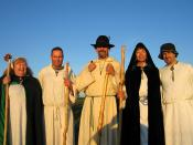 A group of druids from the Sylvan Grove of the Order of Bards Ovates and Druids in the early morning glow of the sun, shortly after having welcomed the sunrise at Stonehenge on the morning of the summer solstice.Left to right: Anne, Richard, Shaun, Marion