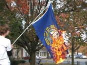 The flag of the US state of New Hampshire being burned.