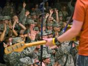 U.S Army soldiers enthusiastically respond to Catchpenny, a Minnesota-based band, during a Memorial Day celebration on Contingency Operating Base Basra, Iraq, May 25. The soldiers are assigned to the 34th Infantry Division, which recently took command of