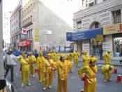 English: Looking north as a Chinatown association do their warmup exercise in 28th Street before joining the parade on Fifth Avenue.