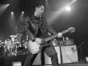 Jonny Wickersham plays guitar in Social Distortion (New York, the Nokia Theatre, 2005 photo by Erika Harding.)